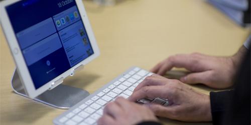 An individual browsing on an iPad.