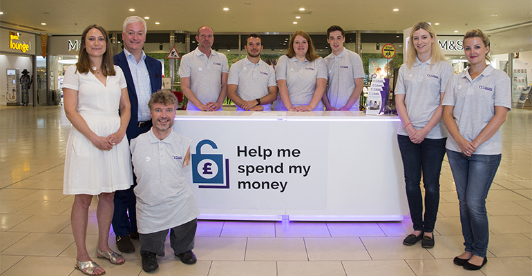 Purple staff at the launch event for our Help Me Spend My Money campaign.