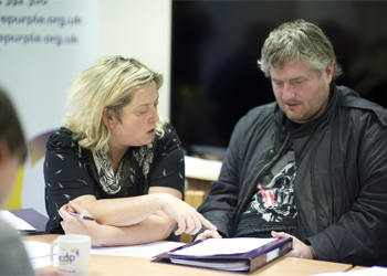 Disabled man being given one to one support by a Purple staff member during a Purple Works session.