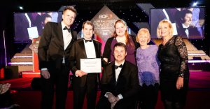 Purple staff members with Jake Humphreys at the BQF Awards ceremony.