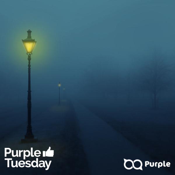 Dark foggy street with street lights